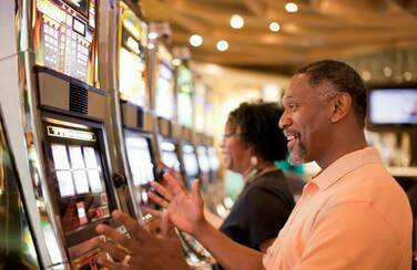 12 58629_Older Couple in Casino GettyImages-119717081